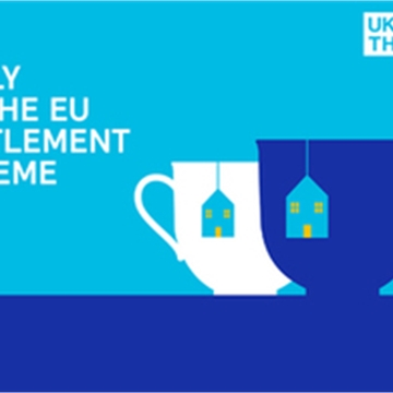 "White text that reads ""apply to the EU settlement scheme"" on a blue background"